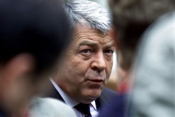 FRENCH TRANSPORT MINISTER JEAN-CLAUDE GAYSSOT TALKS TO REPORTERS ON THE PROTEST AGAINST FUEL PRICES.