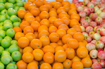 beautiful color combination, lemon and green apple background display at market stall.