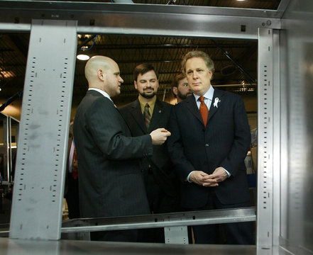 LIBERAL LEADER JEAN CHAREST INSPECTS STEEL FURNITURE MANUFACTURING.