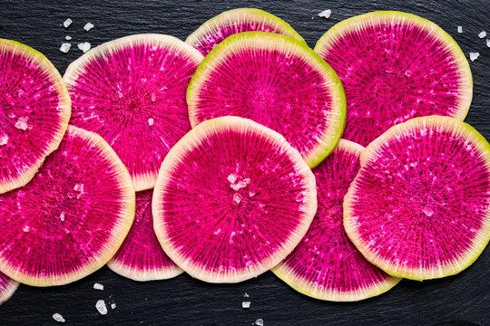 sliced watermelon radish with sea salt