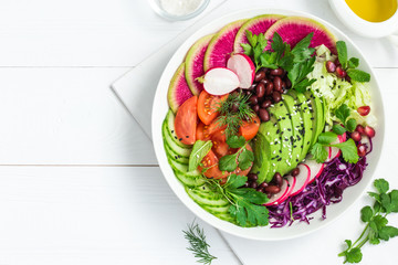 Avocado, red bean, tomato, cucumber, red cabbage  and watermelon radish  vegetables salad