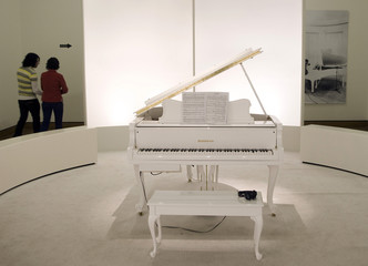 """A white piano where visitors are welcome to play """"Imagine"""" is displayed at Montreal Museum of Fine Arts exhibition titled """"Imagine: The Peace Ballad of John & Yoko\"""