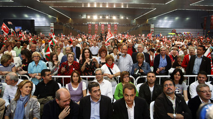 Spain's Prime Minister Zapatero and PSE General Secretary Lopez  are cheered by supporters at the start of the Fiesta de la Rosa in Barakaldo
