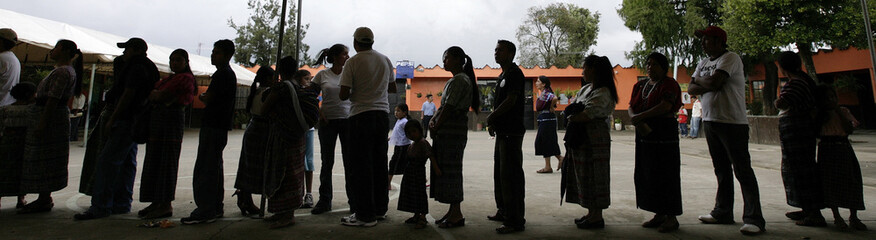 People line up to vote outside a polling station in Santo Domingo