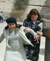 JEWISH WORSHIPPERS RUN FOR SAFETY AT JUDAISM'S WESTERN WALL INJERUSALEM.