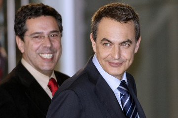 Communications State Secretary Moraleda and Spain's Prime Minister Zapatero smile after televised debate in Madrid
