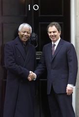 South Africa's Nelson Mandela (L) meets British Prime Minister Tony Blair on the steps of 10 Downing..
