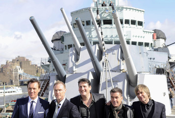 British band Spandau Ballet pose for photographers during a photocall on HMS Belfast in central London