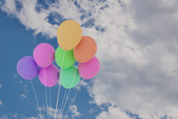 3D rendering of group of balloons on a sky