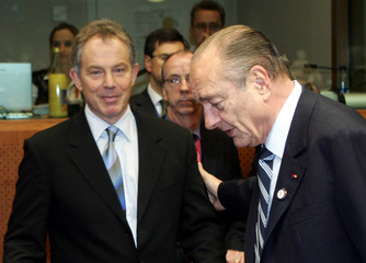France's President Chirac greets Britain's Prime Minister Blair at the European Union heads of state and governments summit in Brussels
