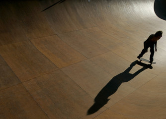 Skateboarder performs during an exhibition in Mallorca