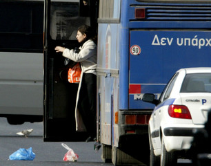 A hostage is released from a hijacked bus at Gerakas suburb some 25 kilometres north of Athens.