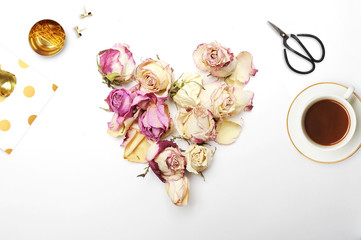 Heart of roses on the white background, top view, Flat lay.
