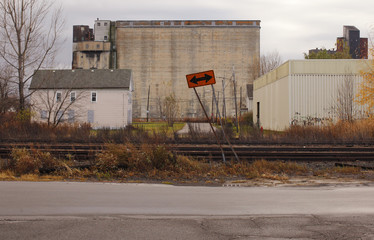 A house sits in front of an unused grain elevator in Buffalo