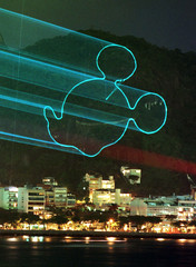 DISNEY LASERSHOW PROJECTS IMAGE OF MICKEY MOUSE ON A HILLSIDE IN RIO.