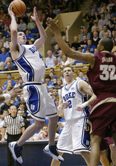Duke University's Redick goes to the basket for two points against Florida State's Johnson during NCAA basketball game in Durham North Carolina