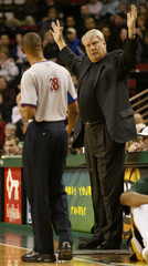 MAVERICKS COACH DON NELSON ARGUES WITH REFEREE DURING GAME AGAINST SONICS.