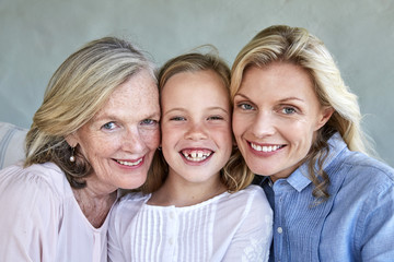 Familiy picture of little girl with mother and grandmother head to head
