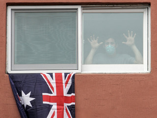 Member of Australian Lacrosse team, who is confined in hotel, poses at window in Suwon