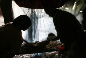 Relatives wash the body of Michu Mohamed, a four-year-old girl who died of malnutrition near Sheshemene