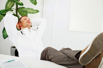 Doctor resting in his office.