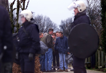 DUTCH RIOT POLICE PROTECT EMPLOYEES OF THE MEAT AND ANIMAL INSPECTION SERVICE PRIOR TO THEIR ...