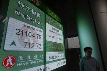 Closing blue-chip Hang Seng Index is displayed at a bank in Hong Kong