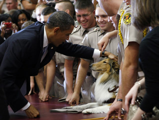 President Obama greets a mascot and cadets after speaking at the Points of Light forum in Texas