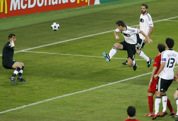 Germany's Klose scores past Portugal's goalkeeper Ricardo during Euro 2008 quarter-final in Basel