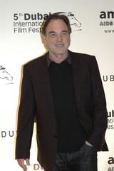 U.S. director Oliver Stone arrives on the red carpet during the Dubai International Film Festival