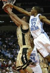North Carolina's Rashad McCants stops Oaklands Cortney Scott short of the basket.
