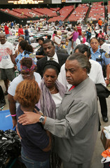 Rev. Al Sharpton and Congresswoman Shelia Jackson Lee talk with woman who lost her children in ...