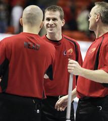 Skip Jeff Stoughton congradulates his team after win in Halifax