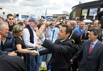 France's President Nicolas Sarkozy visits the 47th Paris Air Show at Le Bourget airport