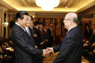 Jia, Chairman of CPPCC National Committee welcomes Wu, chairman of KMT, at beginning of their meeting in Shanghai
