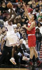 Philadelphia 76ers center Samuel Dalembert shoots over Houston Rockets center Yao Ming of China in Philadelphia