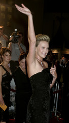 Actress Charlize Theron waves to fans at the premiere of the film 'North Country' in Hollywood