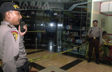 INDONESIAN POLICE GUARD THE ENTRANCE TO A MUSIC STORE WHERE FOUR PEOPLE WERE CRUSHED TO DEATH IN ...