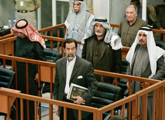 Former Iraqi president Saddam and aides attend trial in Baghdad