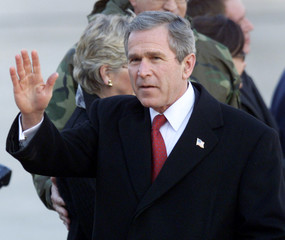U.S. PRESIDENT GEORGE W. BUSH WAVES ON HIS ARRIVAL IN SEOUL.