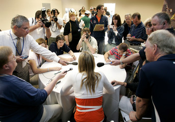 Maria Sharapova is surrounded by members of media at Pacific Life Open in Indian Wells