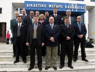 BRITISH AND DUTCH PLANESPOTTERS POSE OUTSIDE COURT HALL BEFORE THEIRAPPEAL IN GREECE.