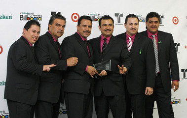 Mexican group Conjunto Primavera poses backstage during the 2008 Billboard Latin Music Awards in Hollywood, Florida