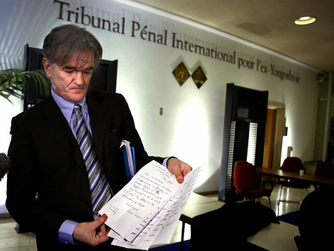 Zdenko Tomanovic, a Serbian legal advisor, displays a handwritten letter by former Yugoslav presiden..