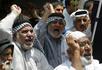 Residents chant anti-Israel slogans after Friday prayers in Baghdad's Sadr city