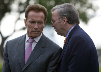 California Governor Arnold Schwarzenegger listens to Google Chairman and CEO Eric Schmidt in San Francisco