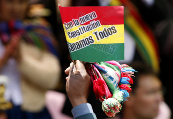 Supporter of Bolivia's President Morales parades during ceremony to give new constitution to the President in La Paz