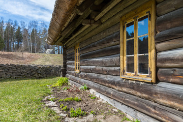 Facade Of Old Wooden House With Windows