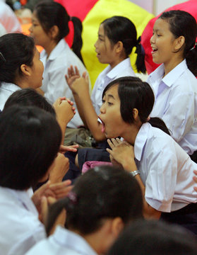 YOUNG THAI GIRL SINGS ALONG AS YOUTH LEARN ABOUT HIV AIDS AT INTERNATIONAL AIDS CONFERENCE IN BANGKOK.