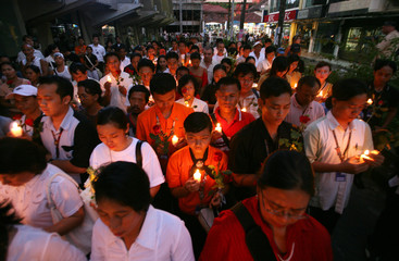 People attend a candlelight vigil in Bali